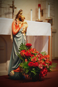 08/21/2010 ***Be humble like Mary so that you can be holy like Jesus. ~ Mother Teresa   This morning, my favorite statue was in front of the Altar with a beautiful bouquet of red flowers. I'm pretty sure these are not the flowers for the week. If I'm correct, I will post another picture to this gallery when the new flowers are up.