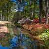 Reflections and garden scene at Azalea Overlook Garden at Callaway Gardens in Pine Mountain, Georgia. Callaway Gardens, which is especially famous for its azaleas, boasts 13,000 acres of gardens and Georgia countryside, plus a conservation nature preserve, extensive education programs, and a very impressive resort as well.