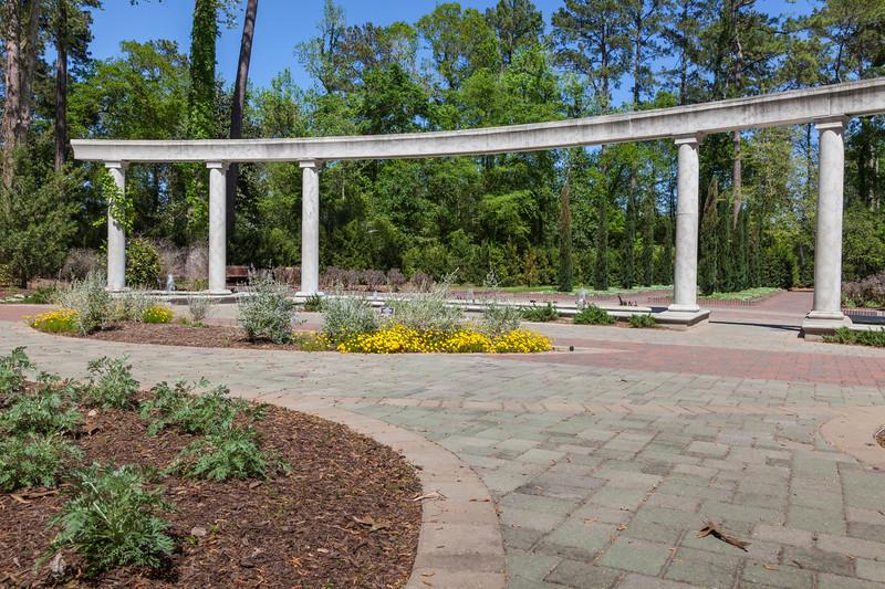 Garden scene with rain sculture at Mercer Botanical Gardens.