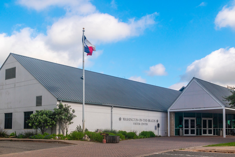 Texas State Flag over visitor center at Washington-on-the-Brazos State Park in Texas.