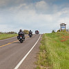 Motorcycle riders enjoying Texas fields of Bluebonnets and Indian Paintbrush along State Highway 362 near Whitehall, Texas.