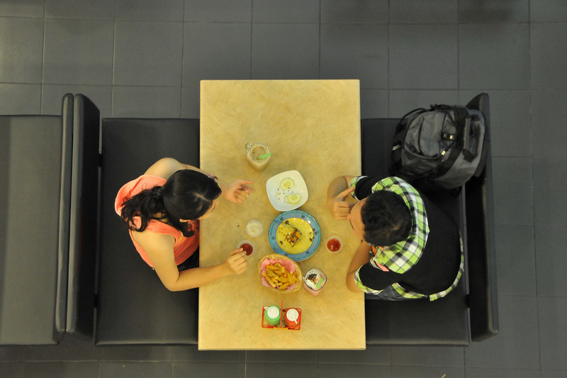 """People eating in a restuarant in Komtar Tower<br /> Jalan Magazine, Georgetown, Pulau Pinang, Pulau Pinang 10300, Malaysia<br /> Penang's tallest building and the sixth tallest building in Malaysia. It is located in the heart of George Town. <br /> <br /> Penang (pronounced /pəˈnæŋ/; (Malay: Pulau Pinang)) is a state in Malaysia which is located on the north-west coast of Peninsular Malaysia by the Strait of Malacca. The name """"Penang"""" comes from the modern Malay name Pulau Pinang, which means island of the betel nut tree. It is the second smallest state in Malaysia. Penang is often known as """"The Pearl of the Orient"""" and """"Pulau Pinang Pulau Mutiara"""" (Penang Island of Pearls)."""