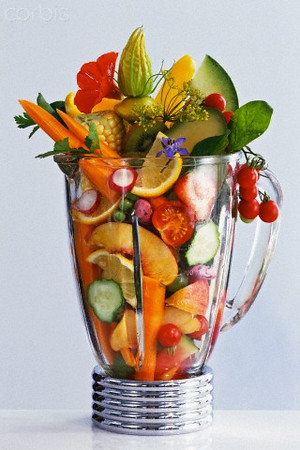 29 Mar 2006, Germany --- A collection of fruits, vegetables, and herbs and flowers in a blender awaiting puree.  --- Image by © Maximilian Stock Ltd/Science Faction/Corbis