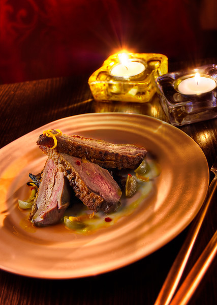 Roasted Duck Breast in a spicy orange-olive sauce with dark fried onions