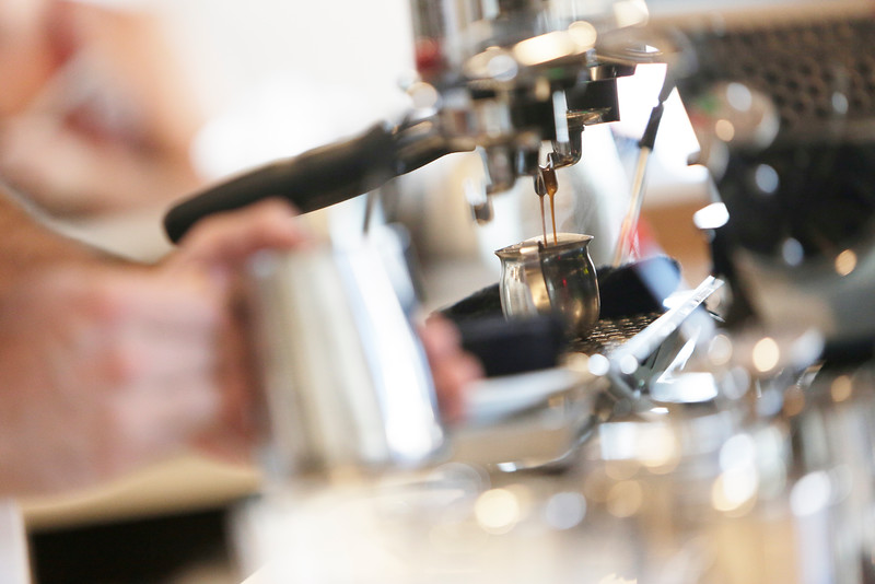 Barista and Machine Tech Jackson Cate makes a vanilla latte for customer Carver Bain, not pictured, at Vessel Coffee Roasters in Spokane, Wash., Thursday, July 14, 2016. (Young Kwak/Pacific Northwest Inlander)