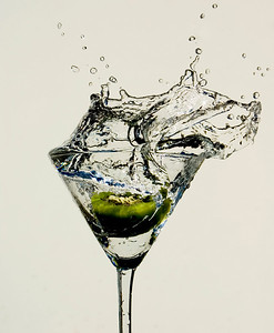 Kiwi Martini--This high speed splash photo was taken in May 2008. All photographs are printed on high quality, professional Kodak metallic paper, unmatted, and shipped to you unframed so that you may choose your own matting and framing materials.