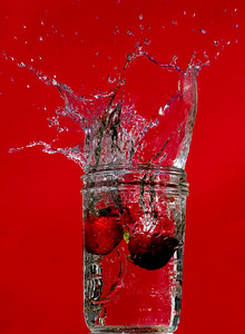 Berry Red--This high-speed splash photo was taken in May 2008. All photographs are printed on high quality, professional Kodak metallic paper, unmatted, and shipped to you unframed so that you may choose your own matting and framing materials.