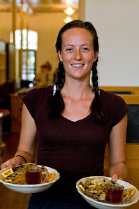 Emily Kourand, waitstaff, bringing Chase's blueberry pancakes to a table.