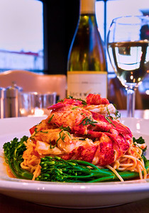 Lobster Fra Diavolo with broccolini and white wine, made by the Old Port Sea Grill, Portland.