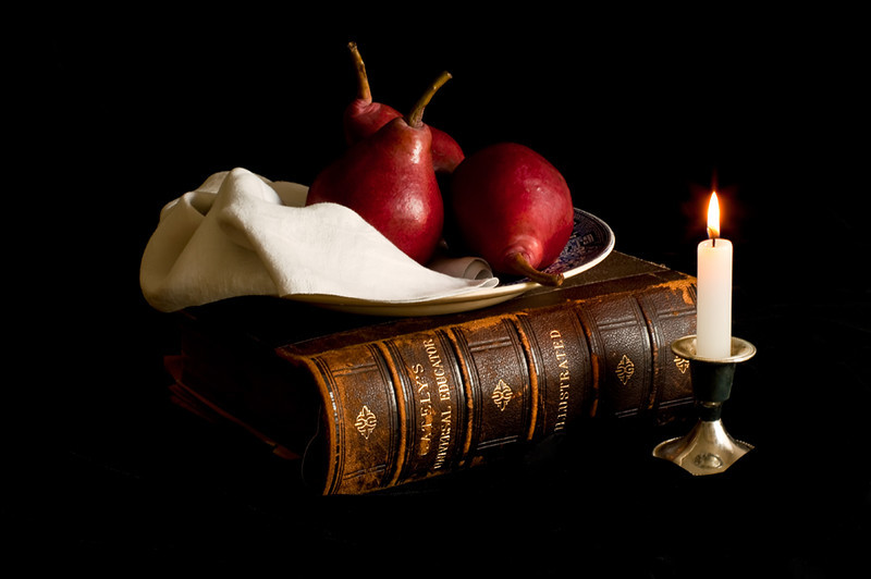 Pears, Antique Book and Candlelight.