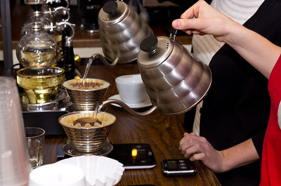 Coffees being poured.