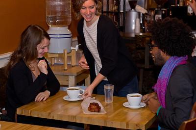 Bethany Moran serves coffee to customers.