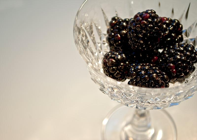 Blackberries in a crystal bowl.