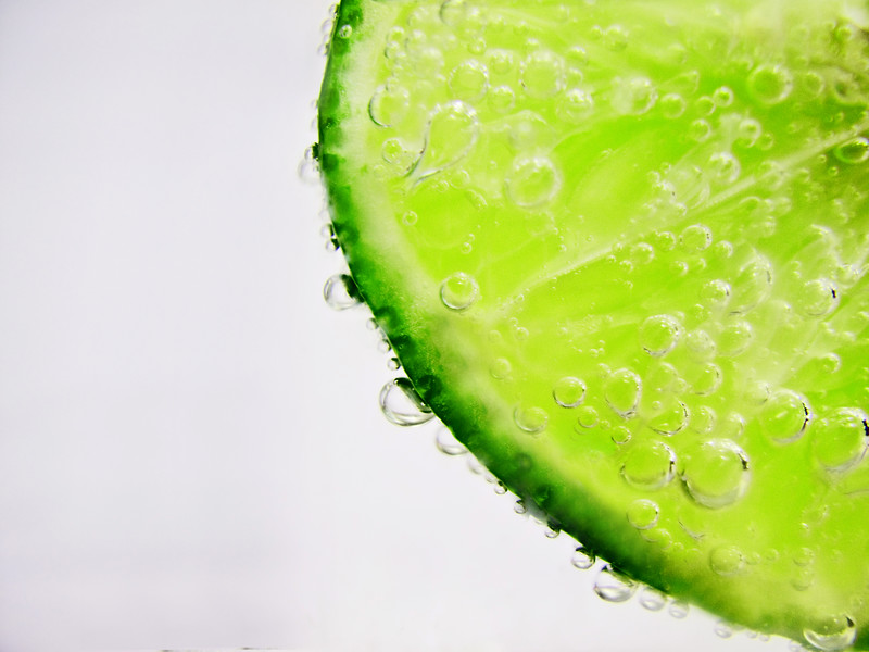 Lime slice with bubbles on it.