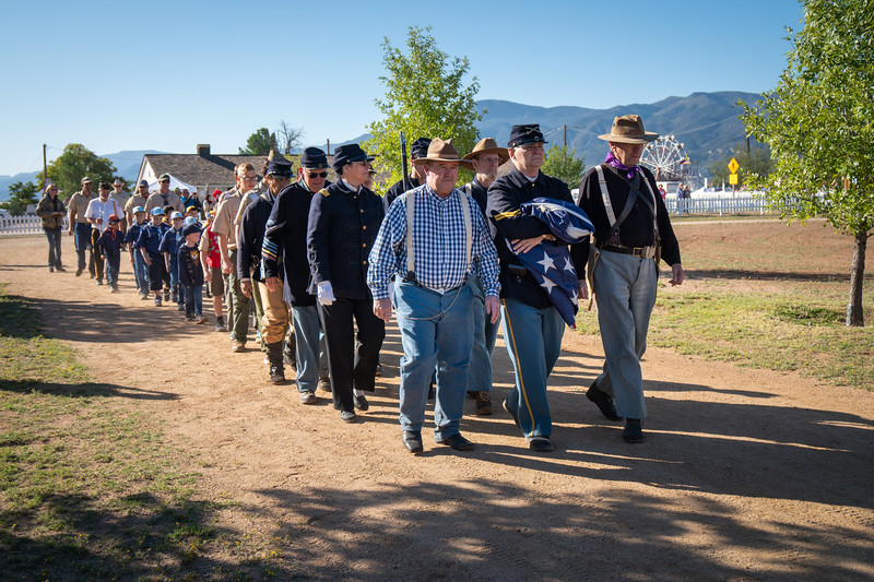 The parade of soldiers and scouts as they march to the flag pole at Fort Verde