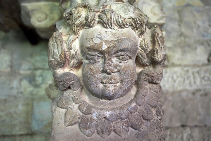 VAISON LA ROMAINE. RHONE. LA CATHEDRALE N.D. DE NAZARETH. CLOSE UP OF AN ANGEL'S FACE.