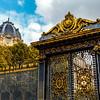 Ornate entrance gate of the Palais de Justice, a courthouse in Ile de la Cite, Paris, France, Europe