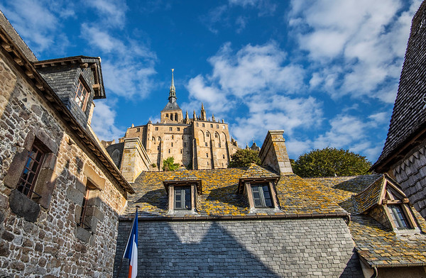Mont-Saint-Michel is an island and mainland commune in Normandy, France. The island is located about a half mile off the country's northwestern coast, at the mouth of the Couesnon River near Avranches.