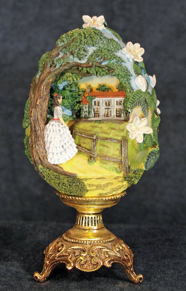 Gone With the Wind -The Franklin Mint<br /> This miniature piece (full height - 4.5 inches) was created for The Franklin Mint collector's egg series. Its size and affordable price made it an attractive collectible for fans of the movie.  This piece uses forced perspective and scene elements to bring together the distant views of Scarlet's home Tara in a minimal amount of space.