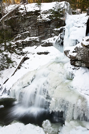 The Kent Falls are a series of waterfalls in Kent, Connecticut. Several falls drop over a course of 250 feet. The falls still move fast enough in this below freezing weather to move water.