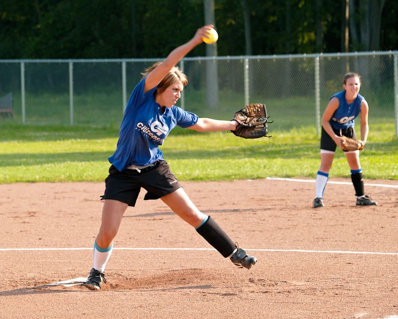 Youth girls softball pitcher in action