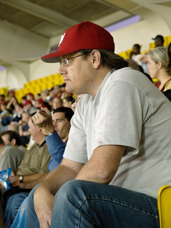 A fan watches his team struggle during the game.