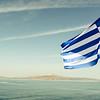 GREEK FLAG ON A FERRY TO THE GREEK ISLANDS. [4]