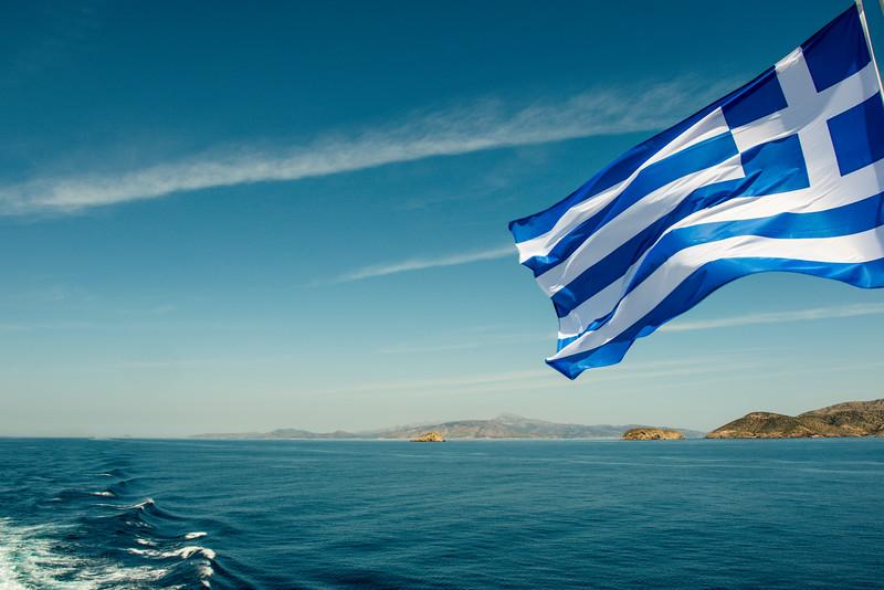 GREEK FLAG ON A FERRY TO THE GREEK ISLANDS. [2]