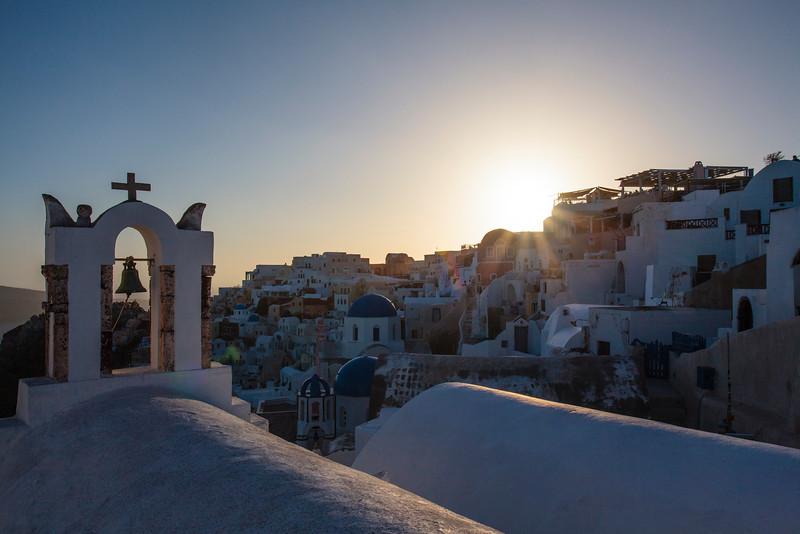SANTORINI. OIA. IA. SUNSET AT GREEK ORTHODOX CHURCHES. THE CYCLADES. GREECE.