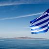 GREEK FLAG ON A FERRY TO THE GREEK ISLANDS. [6]
