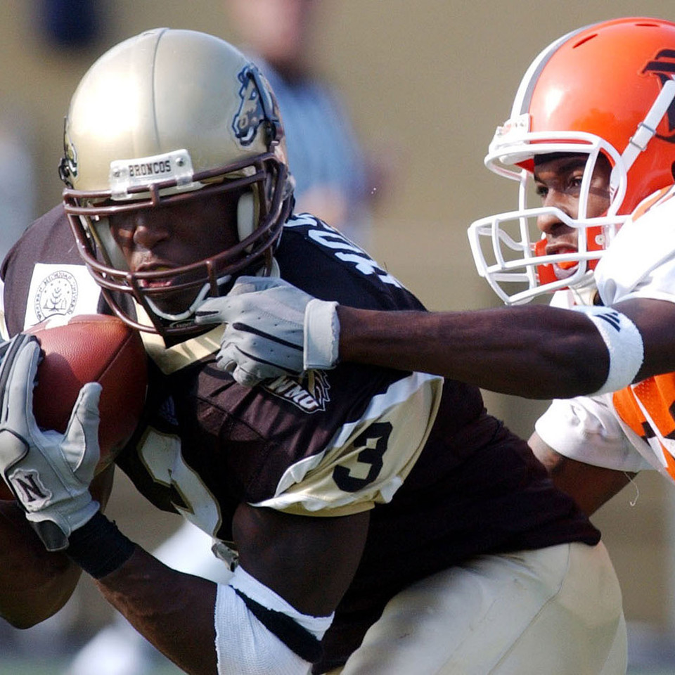 Western Michigan wide receiver Kendrick Mosley gathers in a Chad Munson pass despite the close defense of Bowling Green's Jelani Jordan in the third quarter. Western Michigan University hosts MAC rival Bowling Green State University in Waldo Stadium in Kalamazoo, Mich., on Saturday, Oct. 11, 2003. (Mark Bialek / Special to the Gazette)