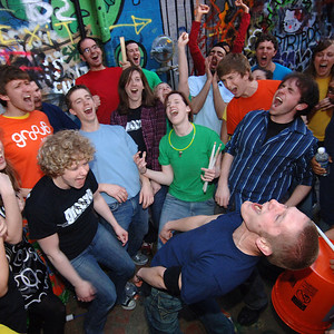"""Members of the group """"Groove,"""" a high energy percussion group, get pumped up before performing at the Michigan Theatre in Ann Arbor on April 11, 2008.  (Photo by Mark Bialek)"""