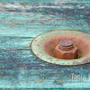 "Sold!<br /> <br /> Rusty connector on an old wooden spool. Red in a field of splintery faded teal. <br /> <br /> Metal print with float mount<br /> 8"" x 12""<br /> $70<br /> <br /> 136"