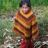 Peruvian child gathering fuel for the cooking fire.