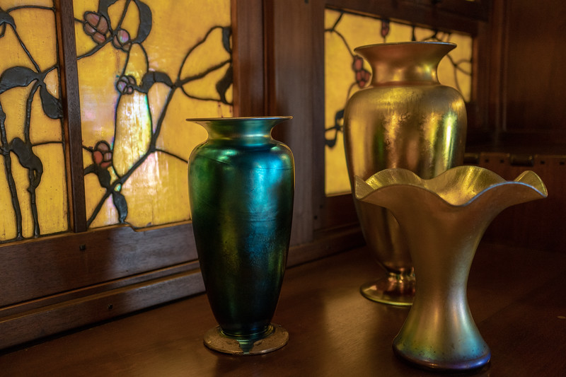 Vases on buffet, in front of dining room stained glass windows