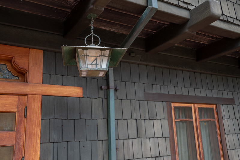 Brass lamp with house number, front porch of Gamble House