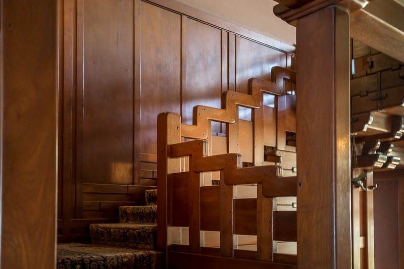 Stairway to  second floor.  Zig-zag banister is one piece of wood.