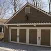 Garage Facelift<br /> <br /> The previous garage facade was void of any character.<br /> The existing garage doors were trimmed and painted to create the look of carraige doors and topped with a new trellis.