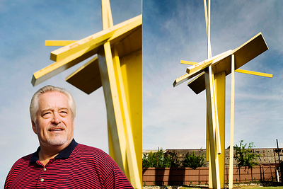 Steel Artist, John Henry, photographed in front of an installation. Part of an airline profile series on Omaha