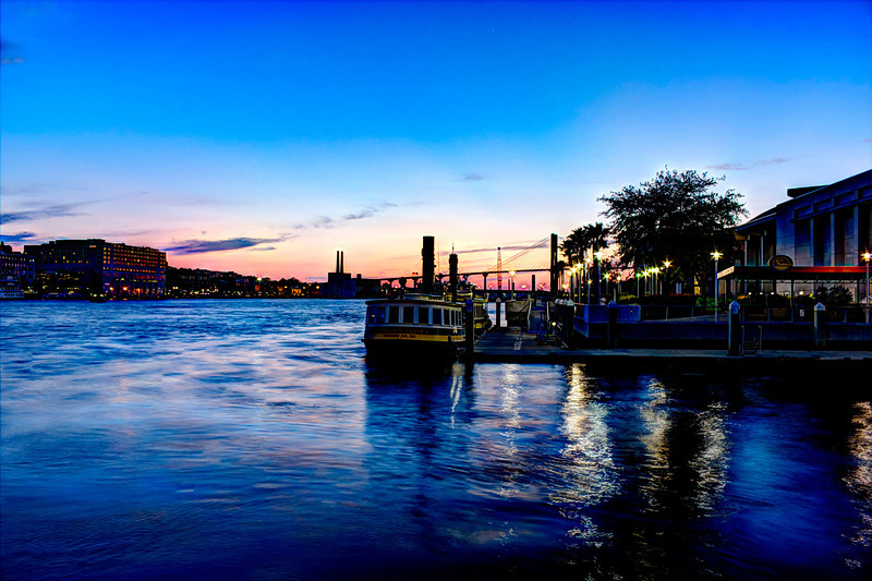 Savannah River Sunset with docked water taxi.