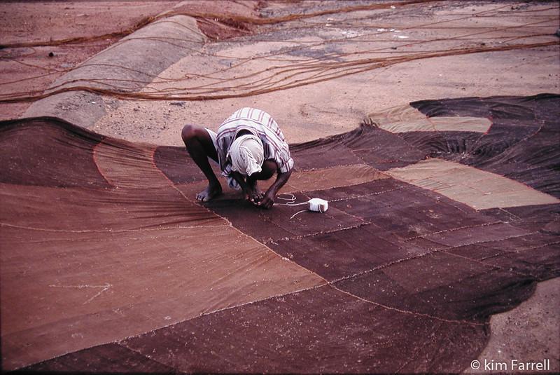 Repairing the fishing nets.  Kollum, India.
