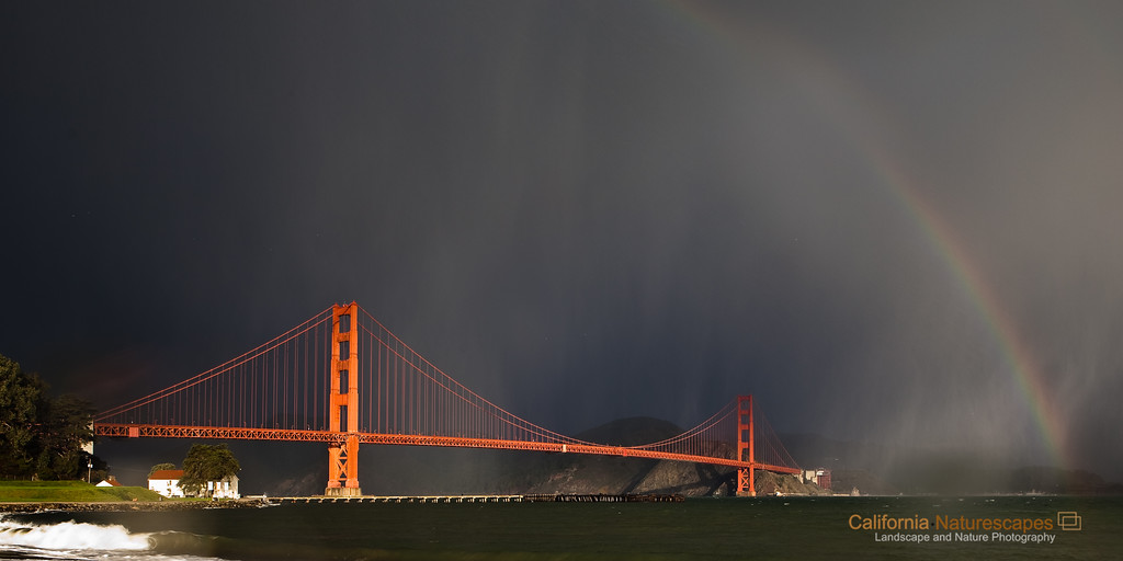 """Golden Gate and Rainbow"" <br>Location: Crissy Field, San Francisco, California.  <p><p>It does not rain much in California, but when it does it can sometimes create very unique lighting conditions. The early morning light on the bridge had wonderful contrast against the dense storm clouds behind the bridge. Adding to the drama the rain had started pouring and even created a rainbow. Soon afterwards the rain caught up to me but I was ready with my rain gear :)  <p>Tech Info and Tip: <br>Lens: Canon 24-70mm f/2.8L @24mm <br>Camera: Canon 5D Mk II <br>Exposure: 1/15sec at f/8 and ISO 50 <br>Filters: Circular polarizer  <p>The circular polarizer helps darken the sky and bring out the contrast in the scene."