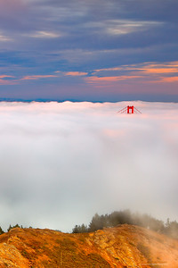 """Golden Gate: Marin Headlands View"" Location: Marin Headlands, San Francisco, California.  Sometimes during summer months the fog rolls in just thick enough to leave the tip of the south tower of Golden Gate exposed. As I drove on the bridge through the fog I could hardly imagine the view I was about to see from the hill. This evening was very special.  Tech Info and Tip: Lens: Canon 24-70mm f/2.8L @42mm Camera: Canon 5D Mk II Exposure: 2.5sec at f/13 and ISO 50 Filters: 2 stop SinghRay ND grad hard edge  The presence of high clouds helped a lot to make this image. Fog in San Francisco is mostly a summer phenomenon when high clouds are difficult to come by."