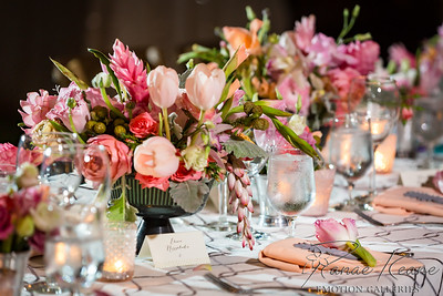 The styling of this was wad so beautiful!  Vintage and Lace designed the wedding tabllesetting with Grace Flower designs and it was photographer by Ranae Keane of EMotion Galleries.  The table setting features serrated edge pink tulups, blush colored roses, pearl ginger, red tourch ginger, peach tulups, off white calligraphy place cards, frosted votives, pineapple guest favors, modern grey printed tablecloth, folded napkins and water glasses.   Beautiful Blush Colors Tablesetting Tip Toe Through the Tulips ©2016 Ranae Keane-Bamsey