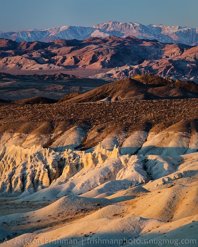 Sunrise illuminates badlands and the White Mountains, Esmeralda County, Nevada, November 2013.