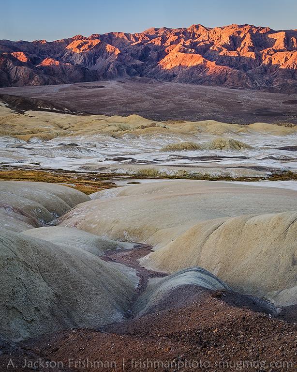Sunrise on Tucki Mountain above the Salt Creek badlands, Death Valley, California, December 2015.