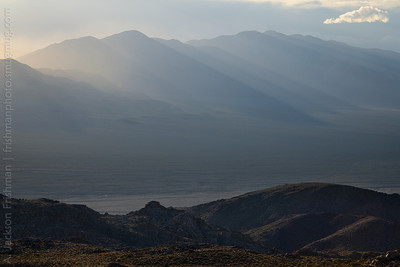 Rays of morning light stream from the Last Chance Range over Eureka Valley, Death Valley National Park, California, March 2014.