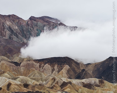 A fogbank from a winter storm rolls over the Twenty Mule Team badlands, Death Valley, California, January 2016.