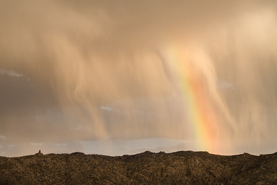 Virga clouds and rainbow over ridges of Piper Mountain Wilderness