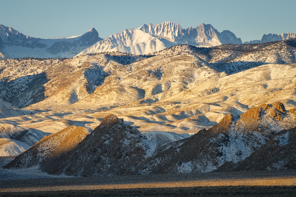 Sunrise on the granite formations of Deep Springs Valley, with the Sierra Nevada above